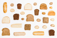 Various Sliced Bread Loaves And Rolls On White