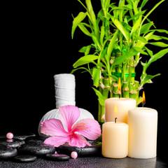 Fototapeta Do Spa spa concept of hibiscus flower, bamboo, thai herbal compress bal