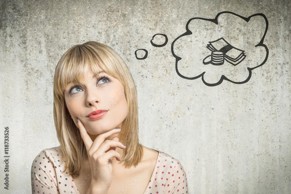 Fototapeta Junge Frau denkt an Geld