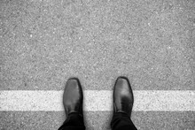 Black Shoes Standing On White Line