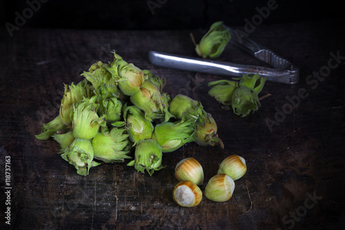 Fresh cobnuts on vintage wooden table