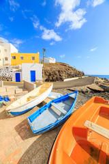 Wooden fishing boats in a small port in El Tarajalejo in Canary Islands