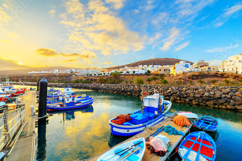 Foto auf Gartenposter Stadt am Wasser Sunset over a port in Gran Tarajal, Fuerteventura, Canary islands