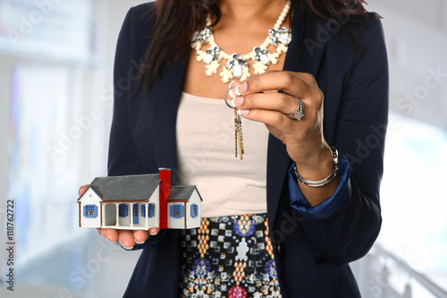 Fotografie, Obraz  Real Estate Agent Holding House and Keys