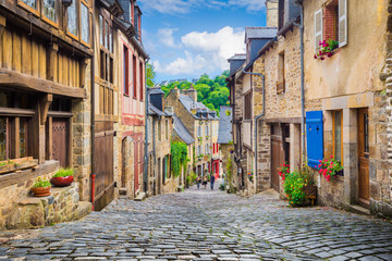 Fototapeta na wymiar Idyllic street with traditional houses in old town in Europe