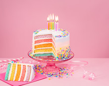 Colorful Birthday Cake Over Pink