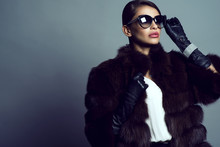 Beautiful Glam Model Wearing White Silk Blouse, Sable Coat, Leather Gloves, Sunglasses And Set Of Luxurious Bracelet, Ring And Silver Chain With Pendant. Natural Furs Concept. Studio Shot. Copy Space