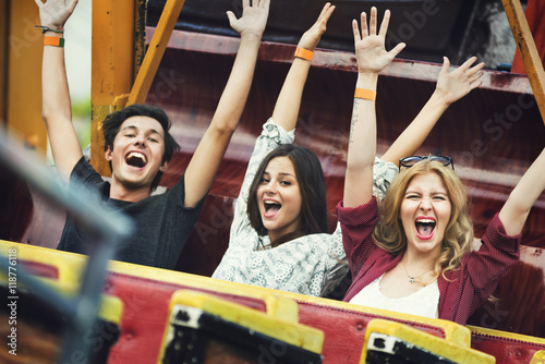 Foto auf Leinwand Vergnugungspark Friends Carnival Ride Fun Hands Raised Concept