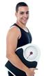 Macho guy holding weight machine