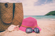 Travel accessories and objects on beach