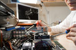 Computer Technician repairing Hardware with tools