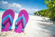 Pink beach flip flop on tropical white sand beach