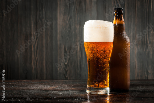Glass of beer and beer bottle