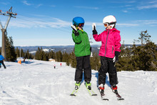 Two Child Skiers Doing A High ...
