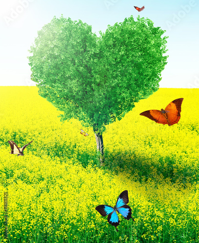 Fotobehang Geel Beautiful field with heart shape tree and butterflies. Abstract landscape background.