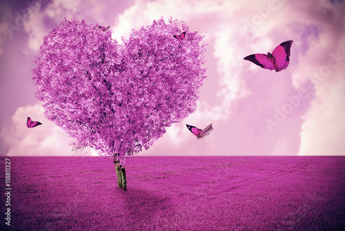 Photo Stands Light pink Beautiful field with heart shape tree and butterflies. Abstract pink landscape background.