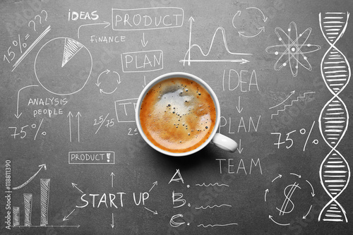 Fotografie, Obraz  Cup of tasty coffee on gray background. Sketch of business plan.