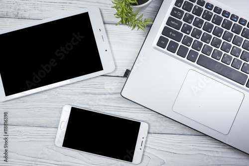 Fotografia  set of modern computer devices - laptop, tablet and phone close up
