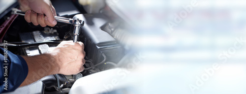 fototapeta na lodówkę Hands of car mechanic in auto repair service.