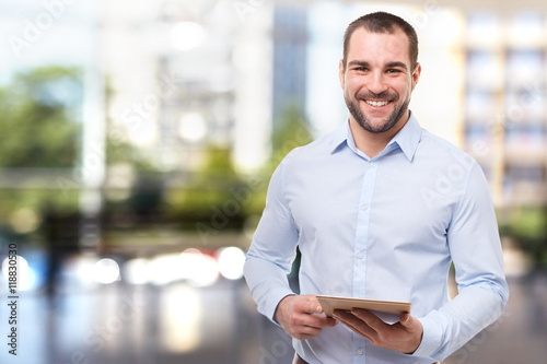 Man in office with tablet computer