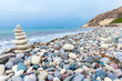 Pyramid of Stones near Sea on Beach