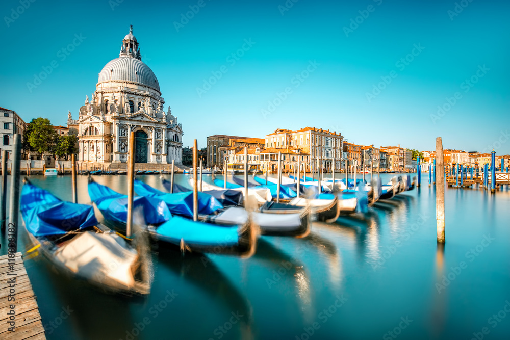 Fototapety, obrazy: Venice cityscape view on Santa Maria della Salute basilica with gondolas on the Grand canal in Venice. Long exposure image technic with motion brured boats