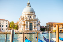 Venice Cityscape View On Santa Maria Della Salute Basilica With Gondolas On The Grand Canal In Venice
