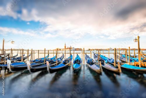 Venice landscape view on San Giorgio Maggiore island with gondolas on the foregr Poster