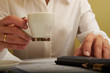 woman working with documents with a cup of coffee