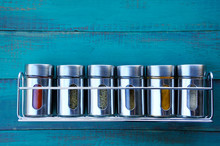 Spice Rack On A Wooden Wall