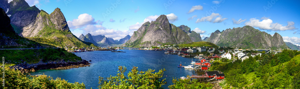 Fototapety, obrazy: Reine in Lofoten Islands, Norway, with traditional red rorbu huts under blue sky with clouds.
