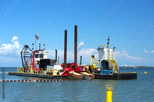 Valokuva  Dredging vessel and a multipurpose work boat work side by side as they excavate