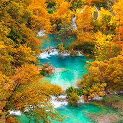 Fototapeta Autumn view on waterfalls and lakesl with turquoise water and g