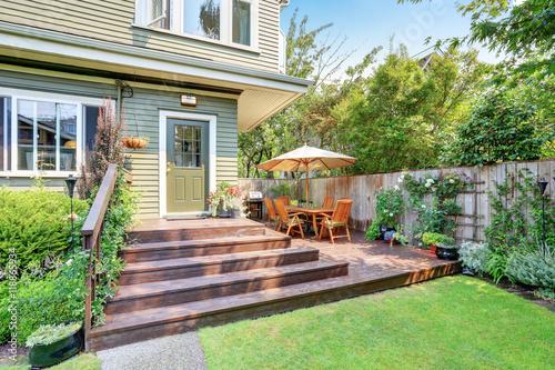 Fototapeta Backyard area with walkout deck and well kept lawn. obraz na płótnie