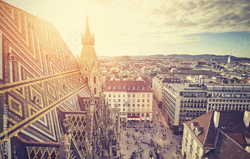 Foto op Canvas Wenen Retro stylized picture of Vienna at sunset, view from the north tower of St. Stephen's Cathedral, Austria.