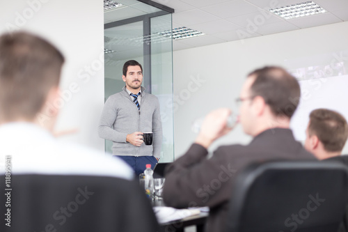 Fotografie, Obraz  Relaxed cheerful team leader and business owner leading informal in-house business meeting