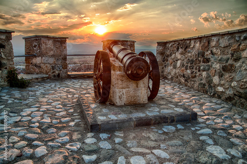Fortification old cannon at fortress in sunset light in prizren city