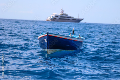 Objects: Small vs big boat - Buy this stock photo and