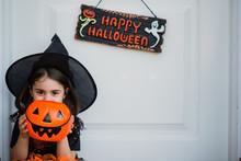 Cute Girl Smiling Behind Of Pumpkin Bag