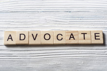 Advocate Word Written On Wood Abc Block At Wooden Background
