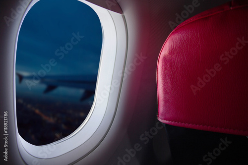 Airplane flying over city night View from window Wallpaper Mural