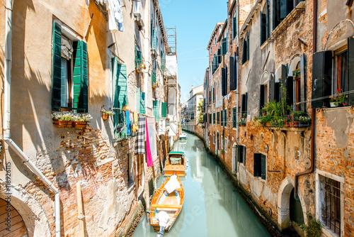 Fototapeta Small romantic water canal in Castello region in Venice obraz