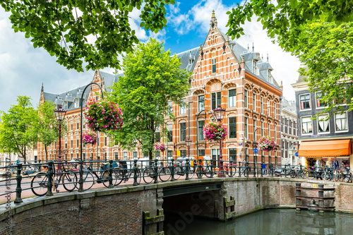 Photo  Typical canal side cityscape of Amsterdam, opposite from the 17th century HQ of