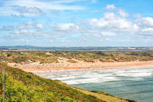 Wall Murals Northern Europe Braunton, United Kingdom - August 13, 2016: Saunton beach is a key component of North Devon's golden coast, part of UNESCO Biosphere Reserve. It is popular beach with surfers and families.