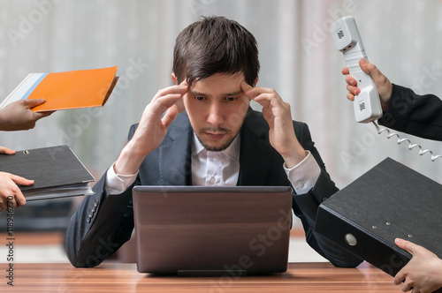 Cuadros en Lienzo Young intend and thinking busy businessman is working with laptop