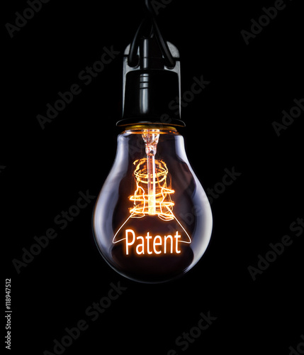 Hanging lightbulb with glowing Patent concept. Canvas Print