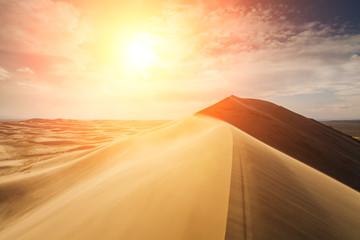 Fototapeta na wymiar High sand dunes in the rays of evening sun