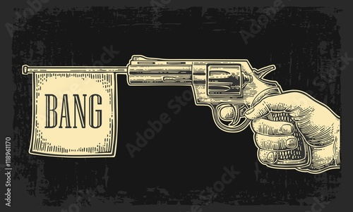 Photo  Male hand holding revolver with bang flag