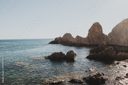 Tuinposter Kust Beautiful sunny seascape with cliffs on coast