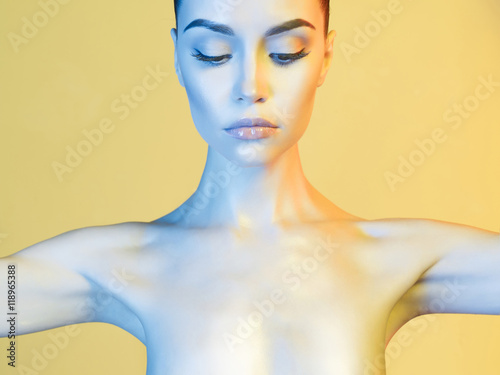Fotografia  Elegant model in the light colored spotlights